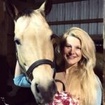 veterinary social worker with horse